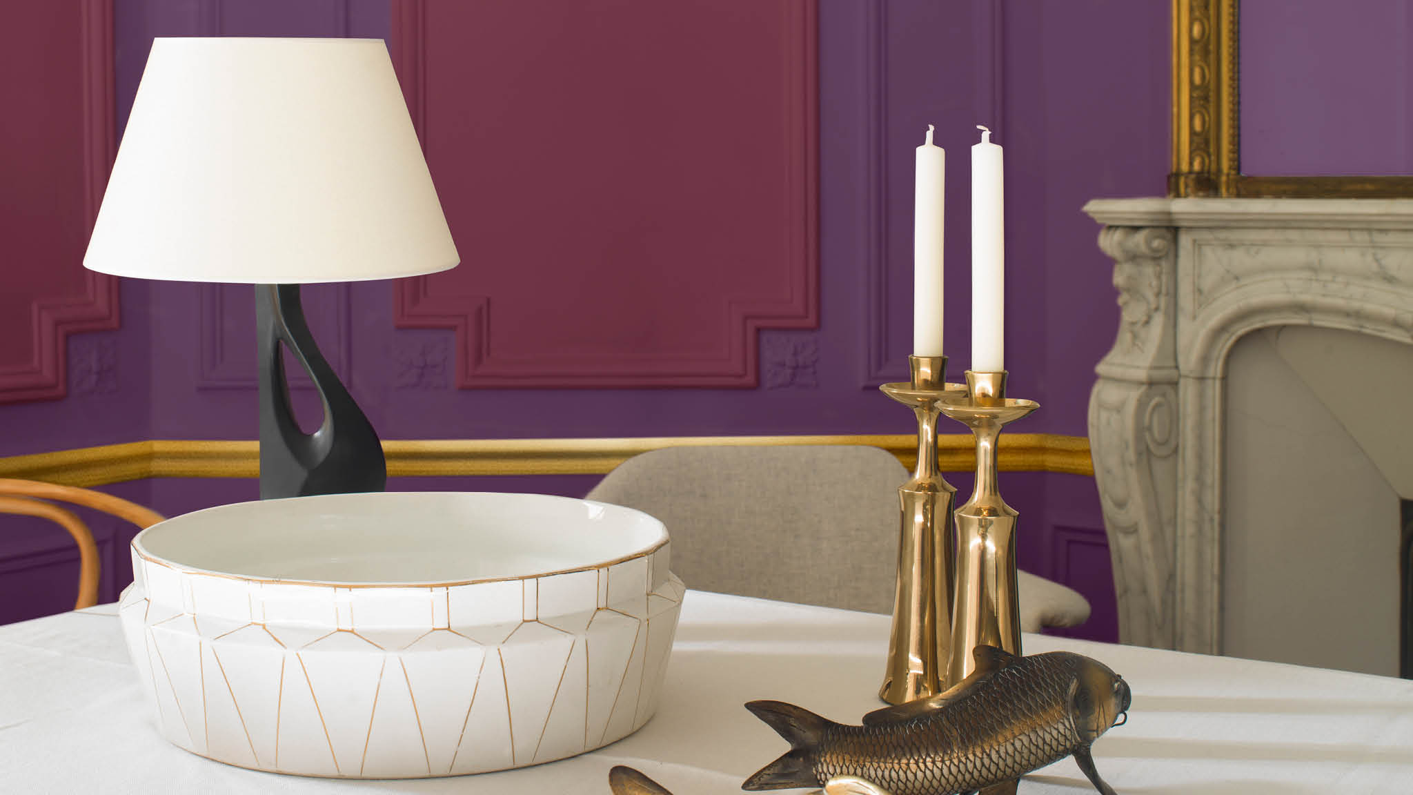 Blend sumptuous shades of purple and deep red to create a dining space brimming with grandeur and opulence. To create a striking focal point, use a rich shade of purple for the walls, and layer with mulberry accents.