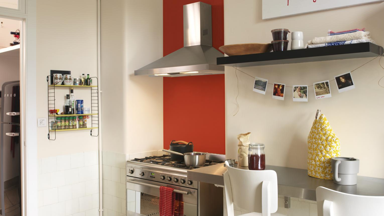 Use a bright standpoint colour to add energy to a plain kitchen.