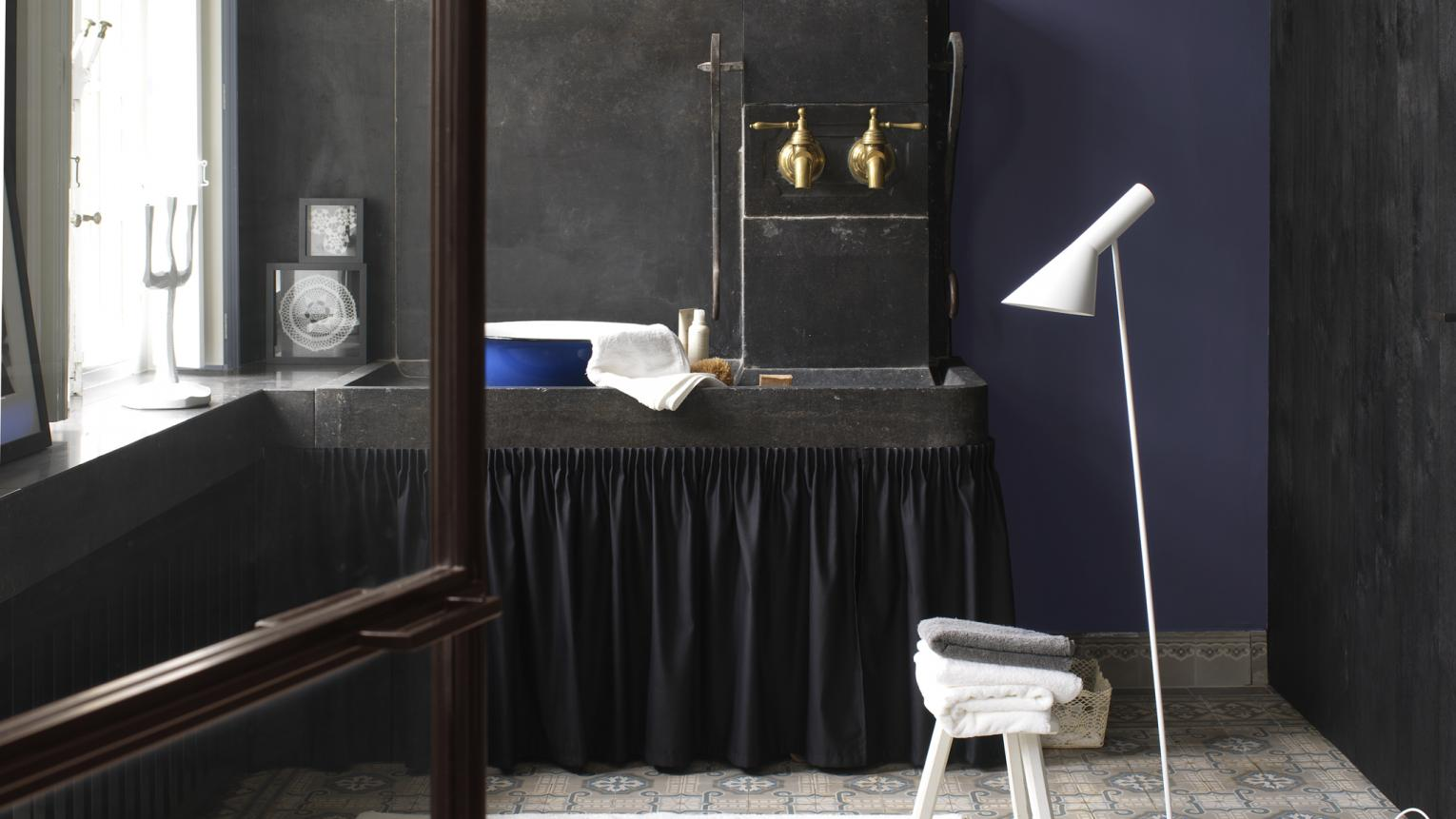 Be bold with deep, intense colours for an affluent bathroom look.