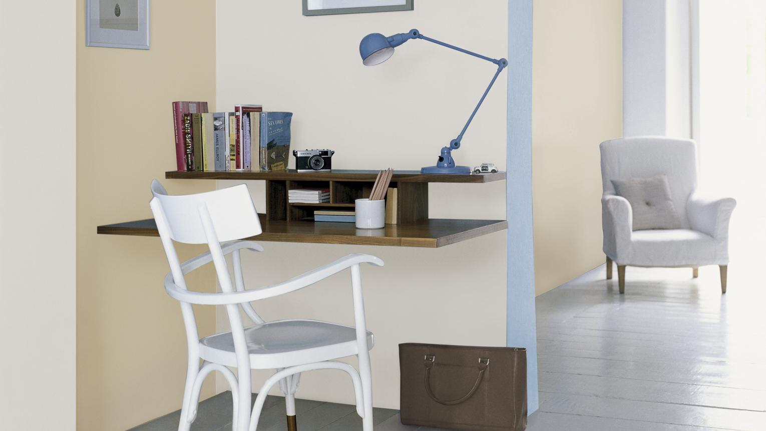 Delicate seaside colours create a light-filled office room.