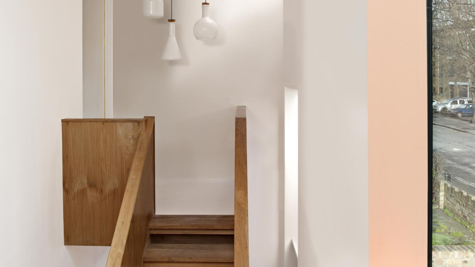 Add width to a tall, narrow room with a dark ceiling.