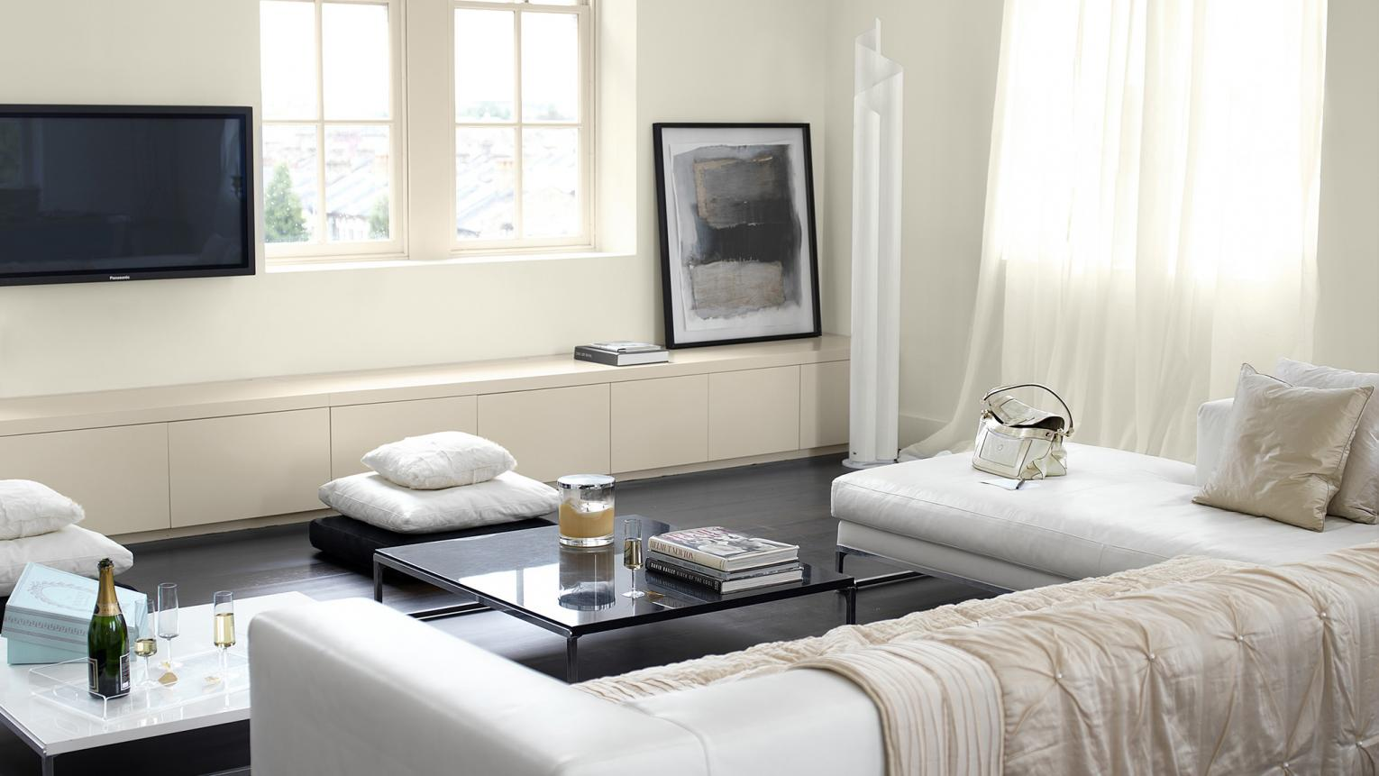 Using different textures in a neutral room creates sophisticated depth.