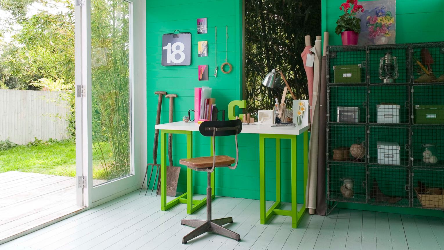 Punchy emerald green contrasts with old office furniture.