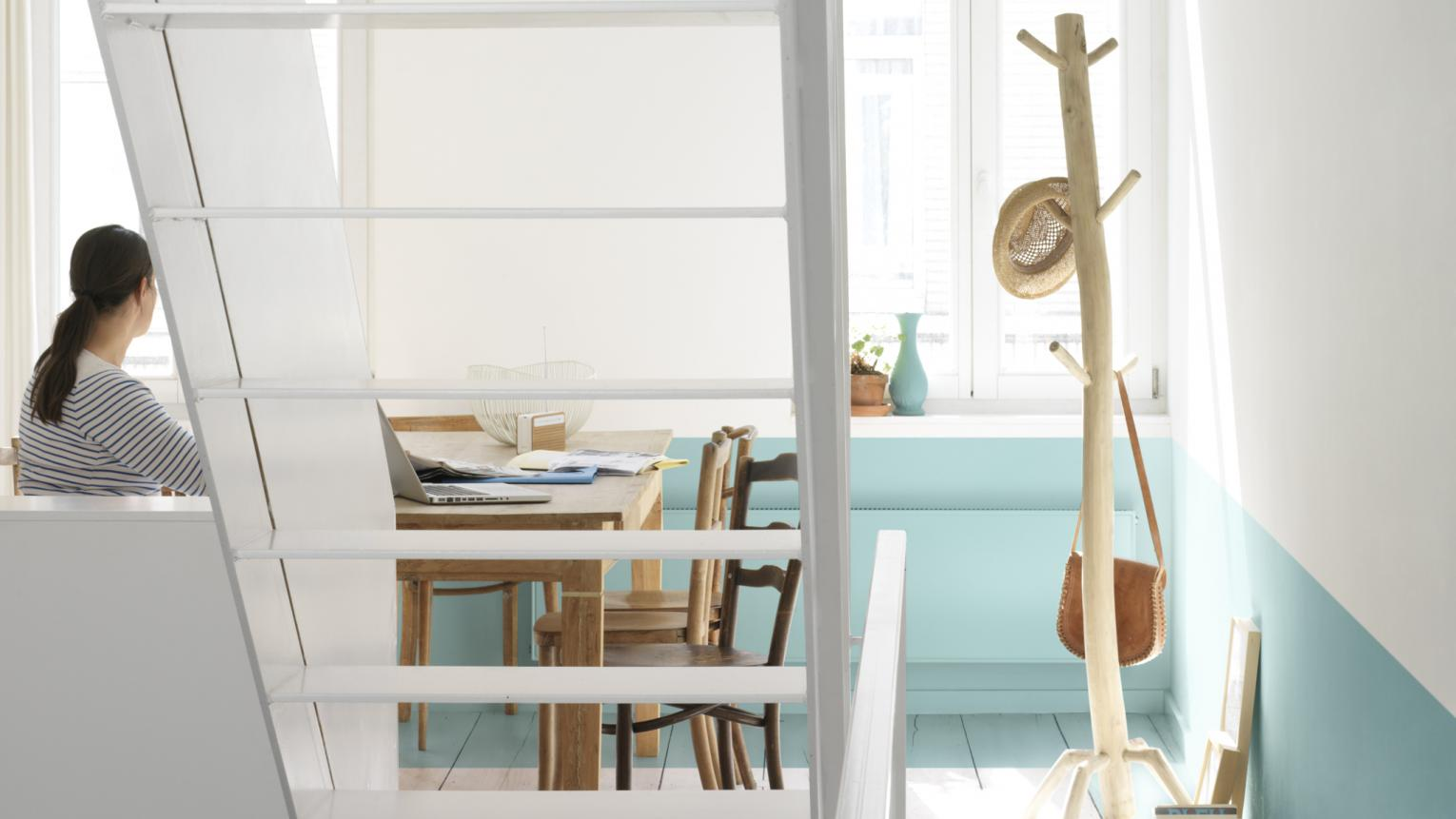 Use bright whites and cool blues to enhance natural light.