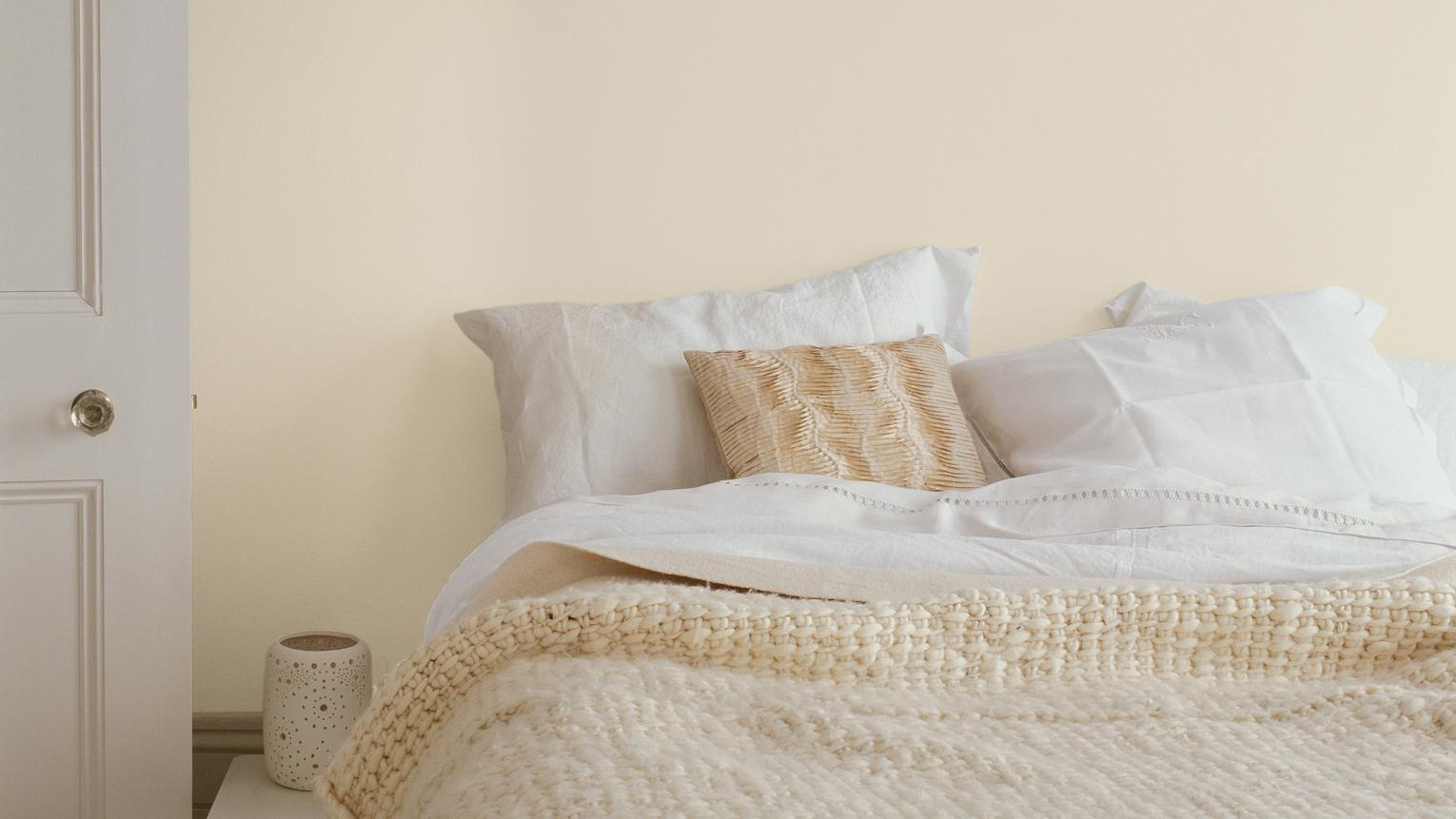 Use cream to create a comfortable bedroom that's full of natural light.