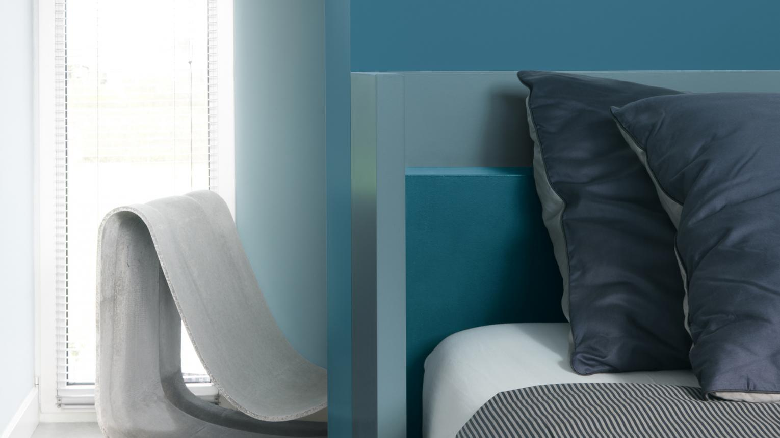 Combine varying shades of teal for a dreamy bedroom feel.