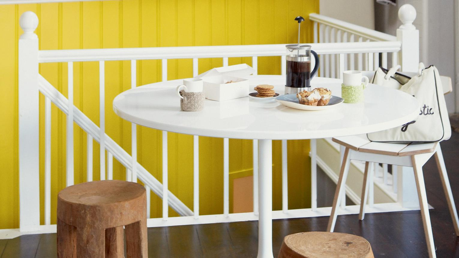 Bright yellow brings fun and energy to this white kitchen.
